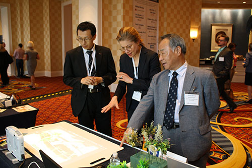 Professor Hong Seung Ko (right) and Associate Professor Ming Hu (left) explains to a visitor